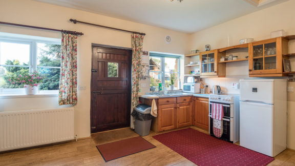 The kitchen is equipped for four and includes a fridge/freezer