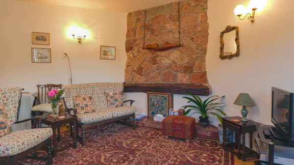 Wainwright has an open-plan living room and kitchen, traditionally furnished