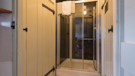 The large shower cubicle with grab-rail