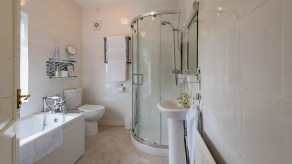The well equipped bathroom with full-sized bath and separate shower cubicle