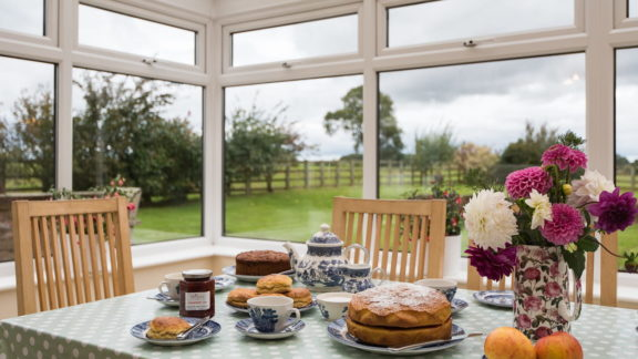 Conservatory dining area - enjoy the view while you eat!