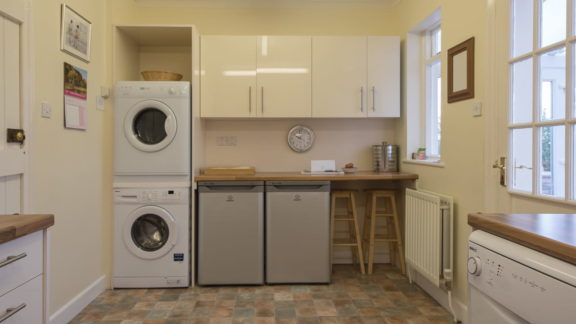Breakfast bar, fridge, freezer, washing machine and dryer