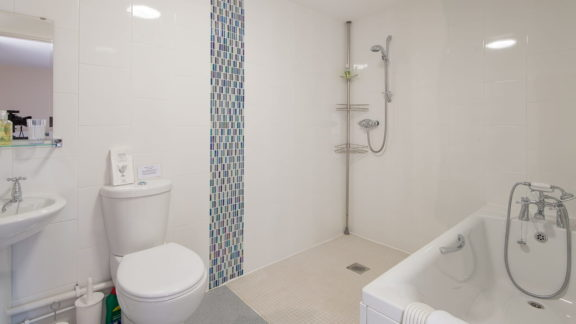 en-suite with bath and wet room shower